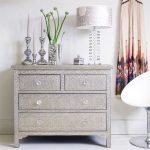 Decorative embossed white metal drawers