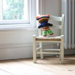 White child's chair with heart detail