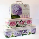 Set of three floral storage cases