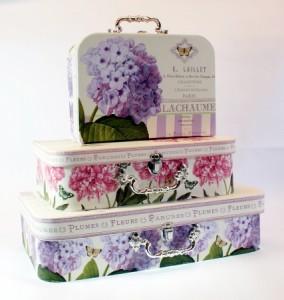Three decorative storage cases