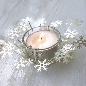 Seasonal glass snowflake candle holder