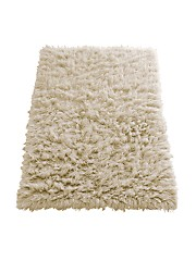 Add a rug with texture and warmth