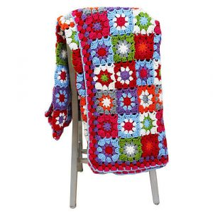 Warm crocheted granny square knitted blanket