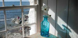 Colourful designer glass flower bottles