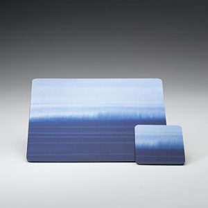 Denby Imperial Blue tablemats and coasters