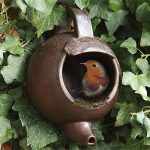 Give a bird a home in a teapot nesting box