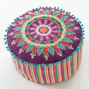 Cosy colourful textile pouffe seat