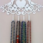 White bird hooks: a nifty necklace storage idea