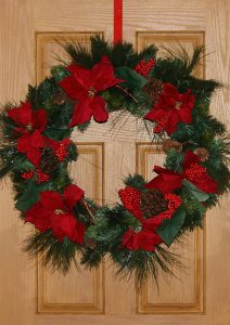 Red and green Christmas wreath for a front door