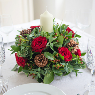 Candle and wreath table decoration
