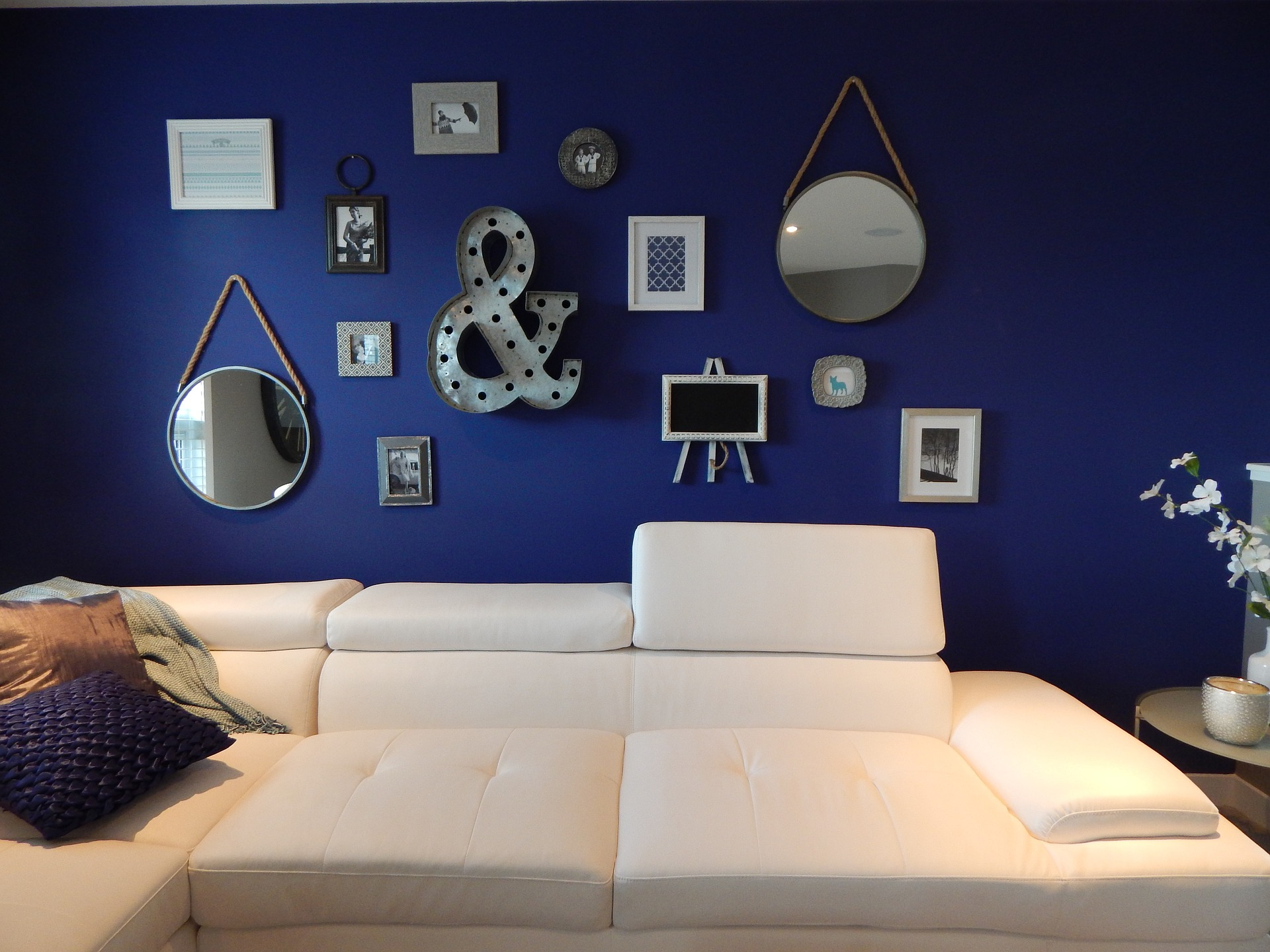 Hang mirrors on a wall to bounce light and create a decorative feature