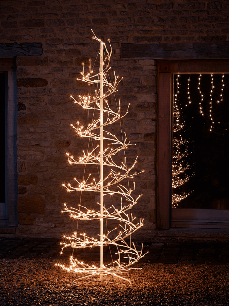 Magical light up outdoor Christmas tree. Make a statement with your outdoor Christmas decorations