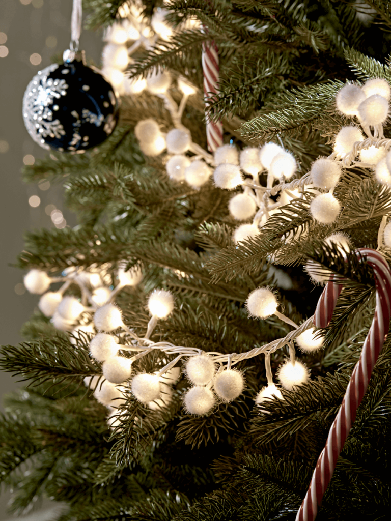 Decorate your Christmas tree with this beautiful pompom snowball cluster light garland