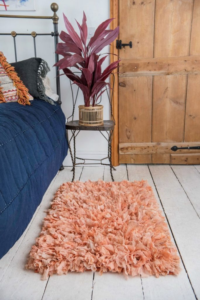 A rug is a great accessory to use on wooden floors - and it's good for keeping your feet warm as you step out of bed!