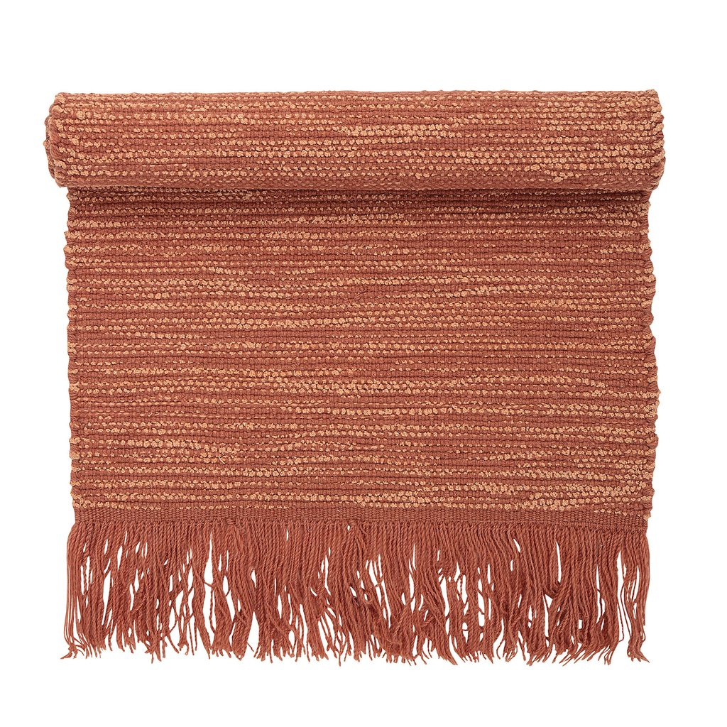 Add a touch of warmth underfoot with this coral wool runner rug