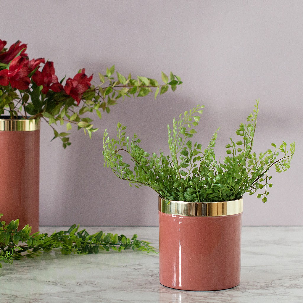 Give your plants an uplift with a new plant pot - this one's in a beautiful living coral shade