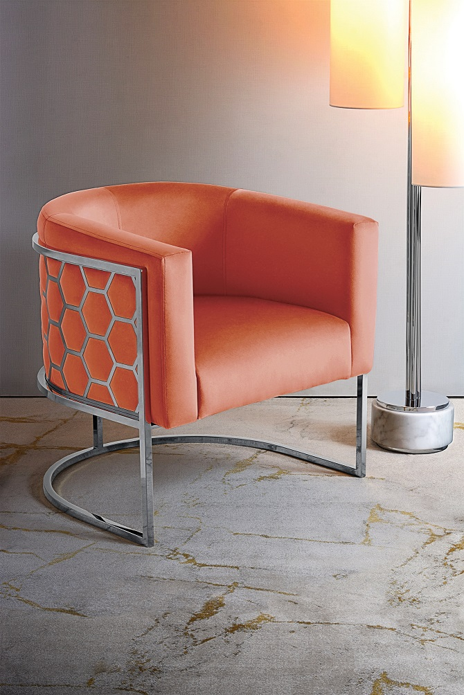 Cosy tub chair in a shade of coral