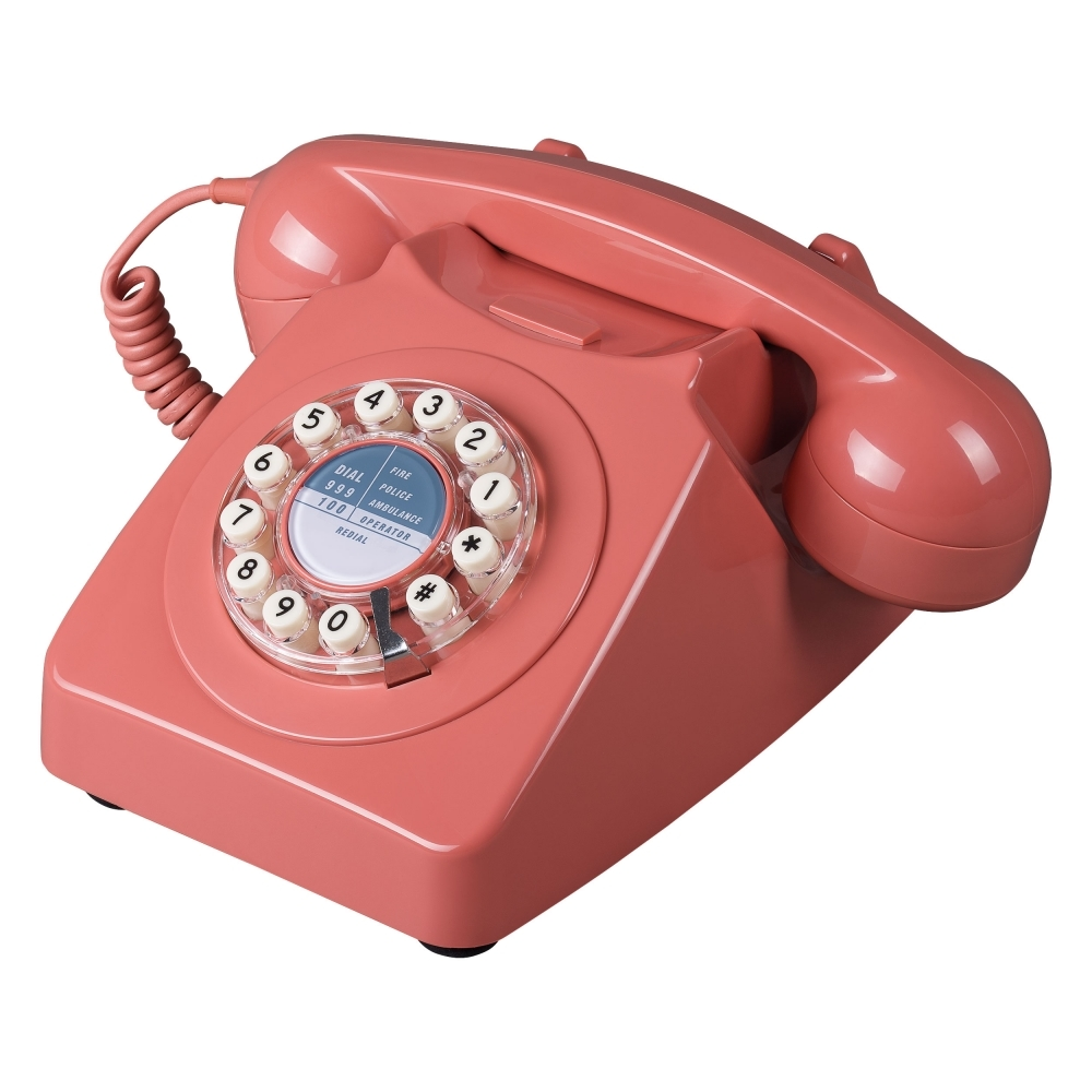 Add touches of the Pantone Living Coral COTY 2019 into your home with well chosen accessories, like this retro telephone