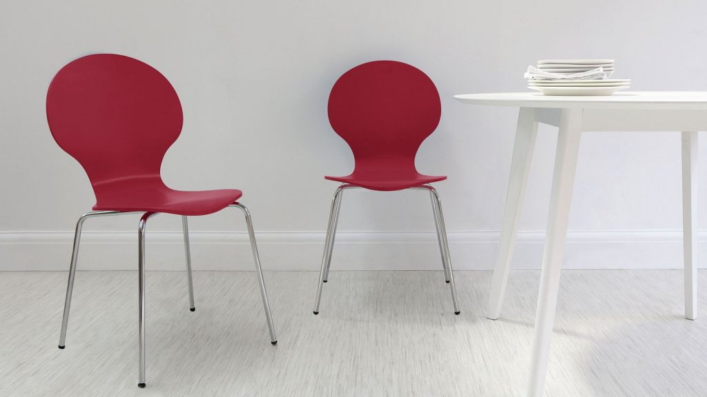 These berry red dining chairs are a lovely shape and a nice contrast against a white dining table