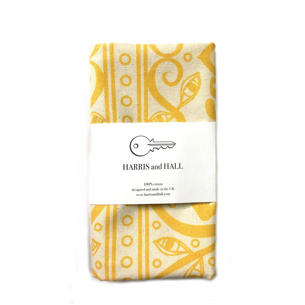 Lovely Gilman print tea towel in yellow, from Harris and Hall.