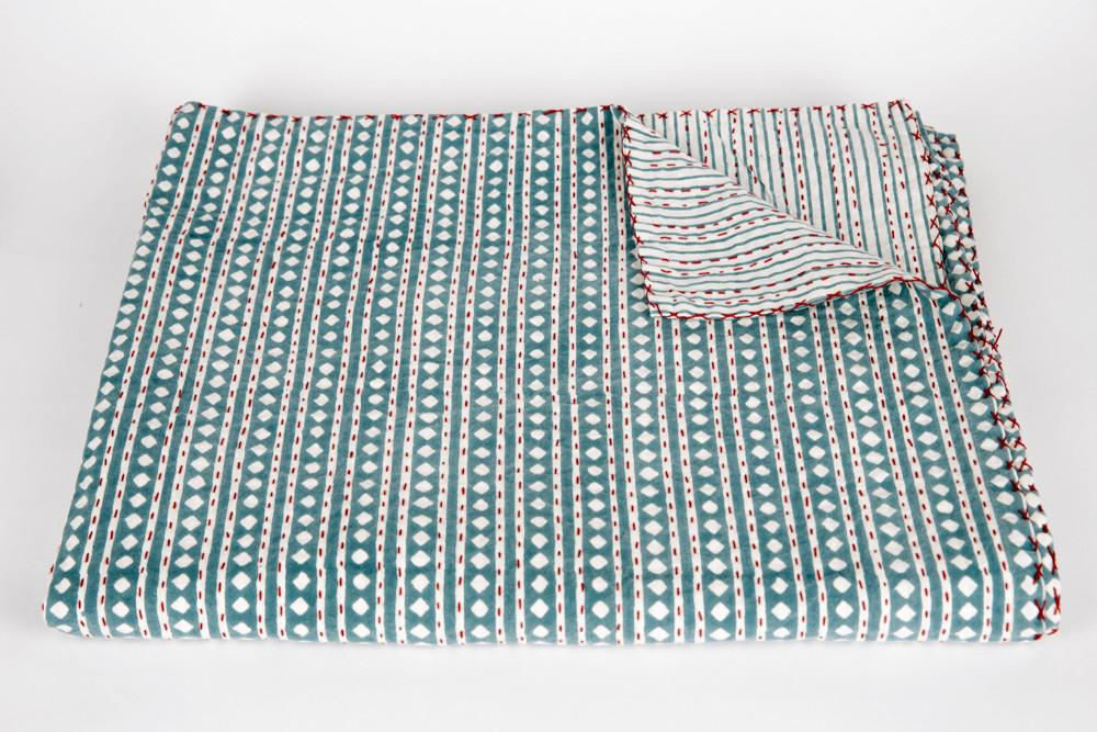 Lovely stripes and dots bedspread throw - a perfect home accessory for the maximalist trend
