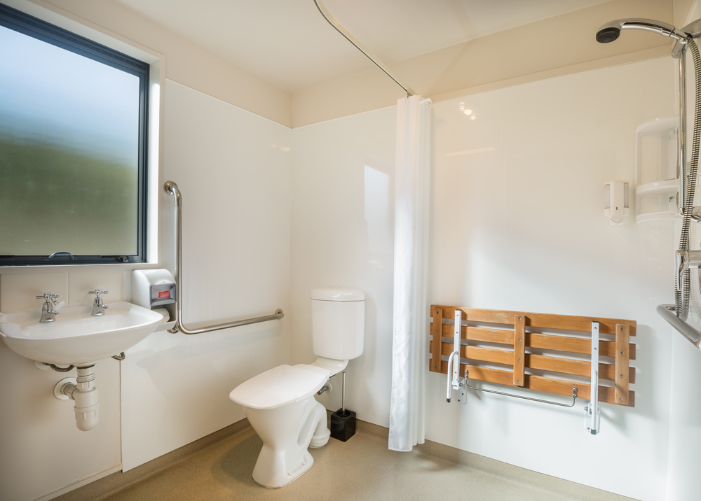 Converting a bathroom into a wet room is a good way to adapt a home due to disability