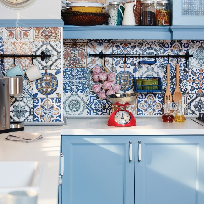 Use traditional colourful patterned tiles to create an eye-catching kitchen feature