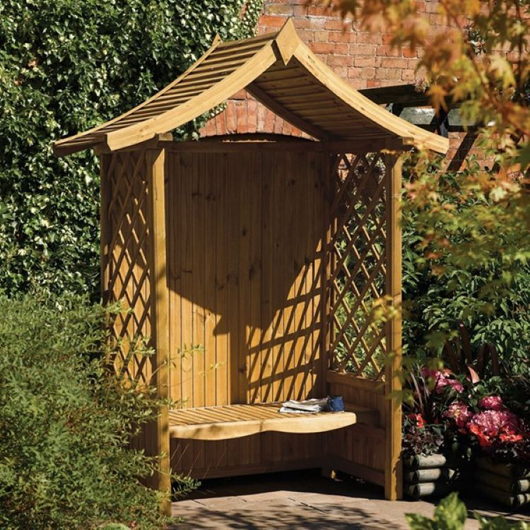 Attractive wooden garden arbour with seat that you can use to create a cosy nook in your garden