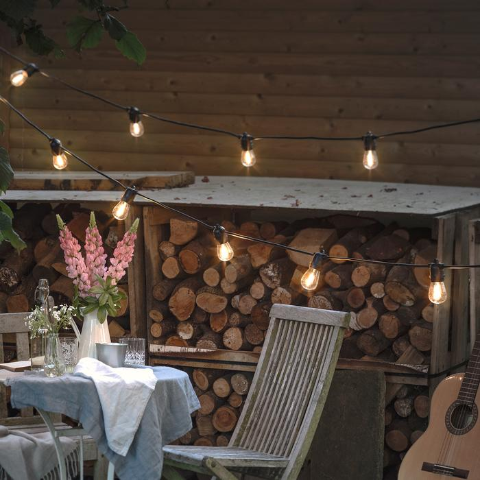 Festoon your garden with lights to illuminate a bonfire night party