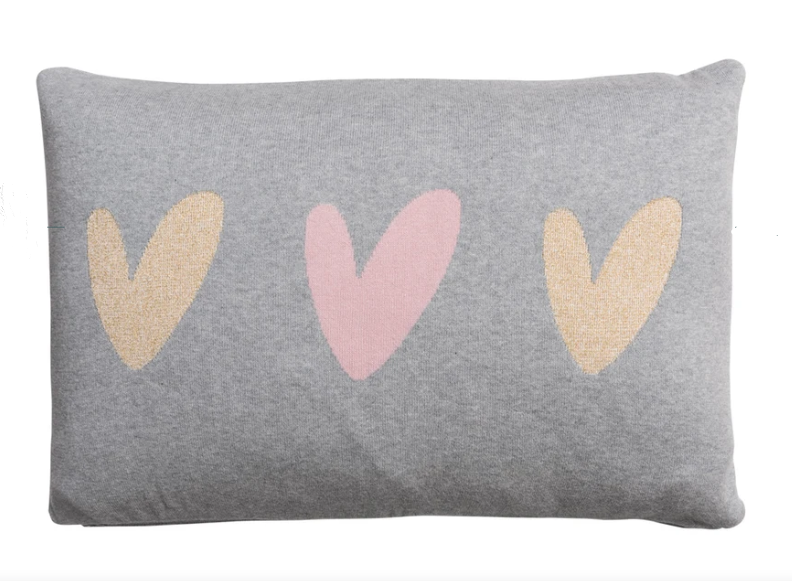 Celebrate love and love your home with this cute heart knitted cushion