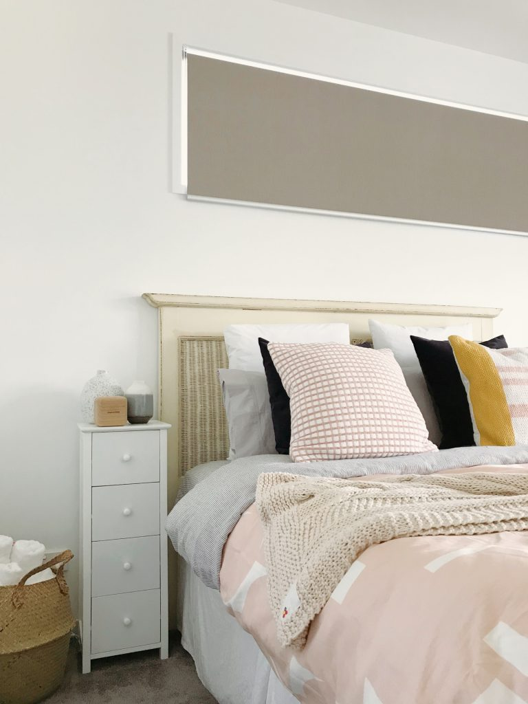 Lovely tones of pink and grey, with mustard accents, give this bedroom a modern touch