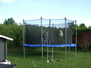 A trampoline in the garden is a good way to encourage kids outside for exercise